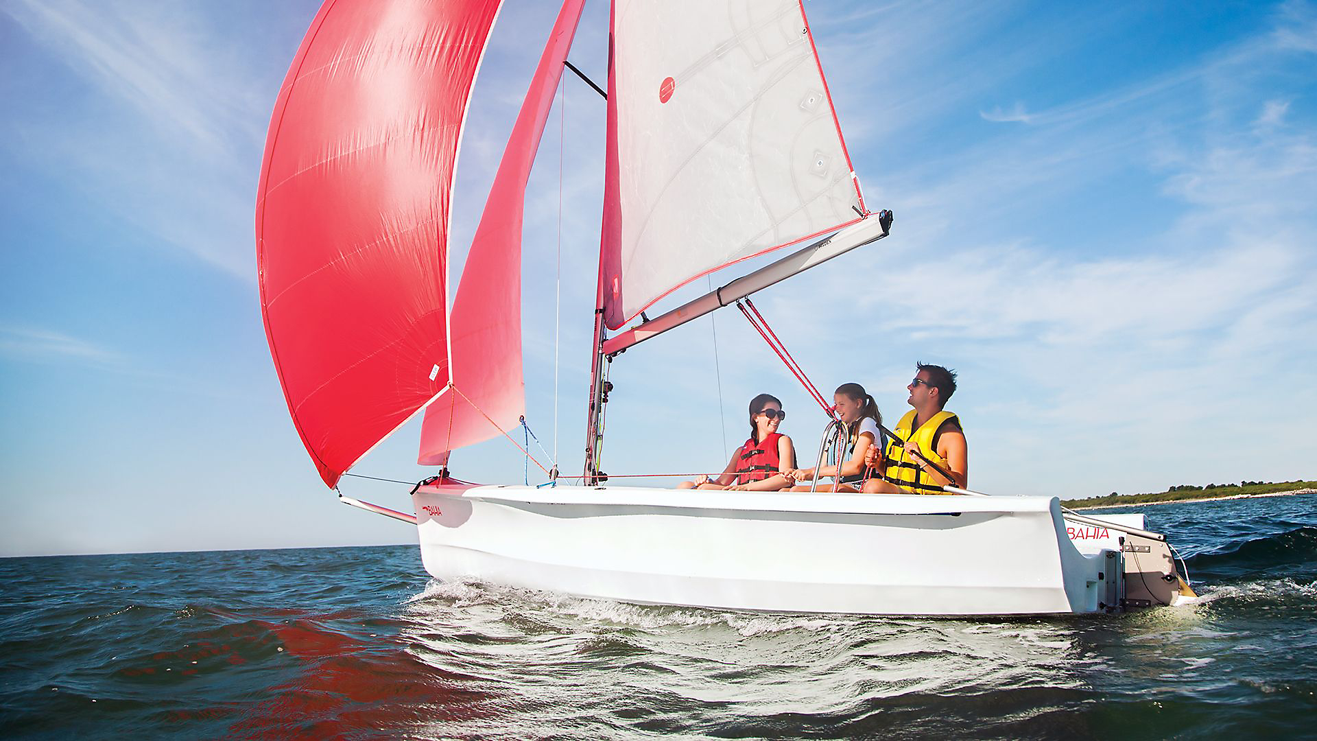 Laser Bahia sailing with a young family